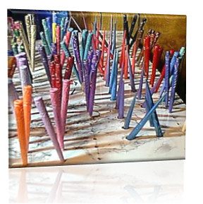 Freshly painted sticks drying on the beading table in the LongLocks HairSticks Studio